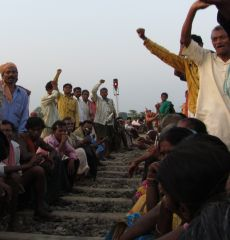 Slogans are chanted from the railway blockade.